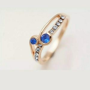 Rose Gold Blue Sapphire Diamond Ring